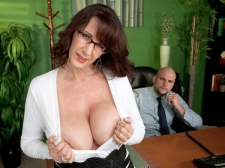 Fucking the massive titted M.I.L.F. who's wearing glasses