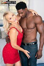 Sandy Pierce copulates a larger than typical, black cock